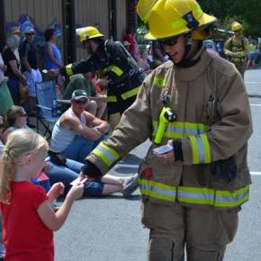 Volunteer firefighter Kristina Liu distributes stickers to the kids. Photo by Laurelle Walsh