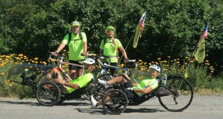 Bill and Dana Brown, standing, left to right, and Dan Zimmerman and Catherine Brubaker, on recumbent trikes, left to right, were one week into their 5,200-mile bike ride when they stopped in the Methow Valley over the July 4 weekend. The group organized the Spokes Fighting Strokes ride (which finishes in Key West, Florida) to build awareness of the potential for cycling to aid in recovery—and provide independence and mobility—for survivors of strokes and of other brain injuries. Photo by Marcy Stamper