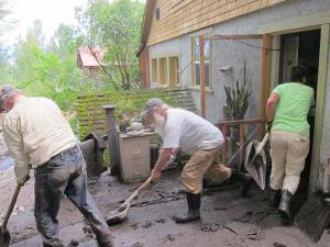 A shovel brigade moved mud out of the Elk/Lewis home. Photo by Don Nelson