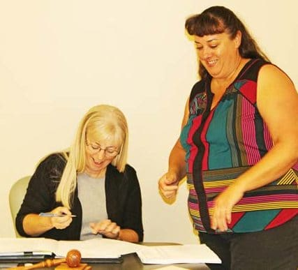 Photo by Don Nelson Winthrop Mayor Anne Acheson, left, and Town Clerk Michelle Gaines make it official at Acheson's swearing-in last week.