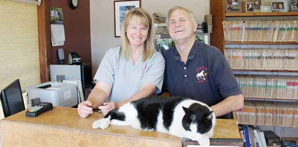 Photo by Don Nelson Veterinarians Terri and Dan DeWeert (with Barn Cat) volunteer their services at the Methow Valley's two annual rodeos.