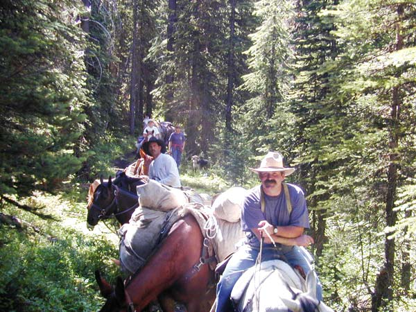 Photo courtesy of Callie Fink Ellis Fink, foreground, on the trail: a consummate horseman and accomplished outdoorsman.