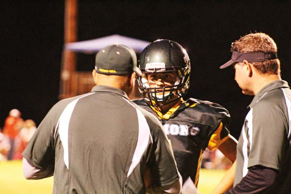 Photos by Don Nelson Liberty Bell head coach Steve White, left, talks over strategy with Mountain Lions quarterback Tanner White during a time out.