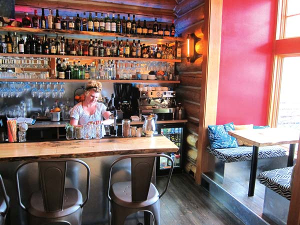 Photo by Don Nelson Amy Days prepares a drink at the new Moonshine Bar, which used to be a small library at the Freestone Inn lodge.