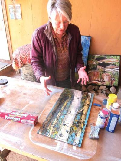 Photo by Don Nelson Ginger Reddington discussed how she hopes to restore one of her paintings that was damaged in the Twisp River Pub fire.