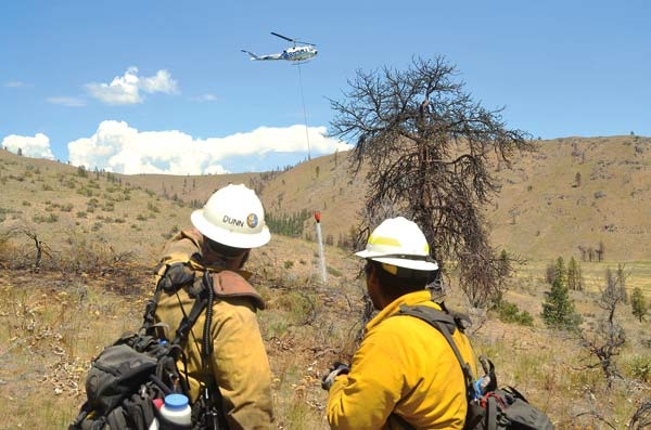 Photo courtesy of Robert Thomas Okanogan County Emergency Management reported that the 2.5-acre fire on Russian Hill Tuesday was 70% lined around 3 p.m.