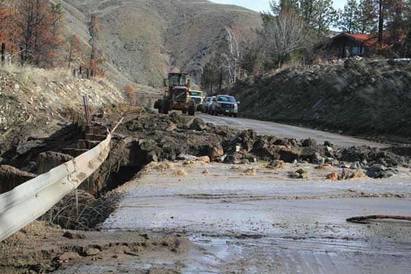 Photo by Marcy StamperThe most serious of three mudslides near Black Canyon sent water, mud, rocks and other debris across Highway 153, blocking the roadway and spilling over the edge of the pavement on the east side of the highway.