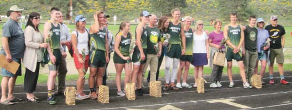 Photo by Don Nelson Seniors and their parents were honored at the Liberty Bell Invitational track meet last week.