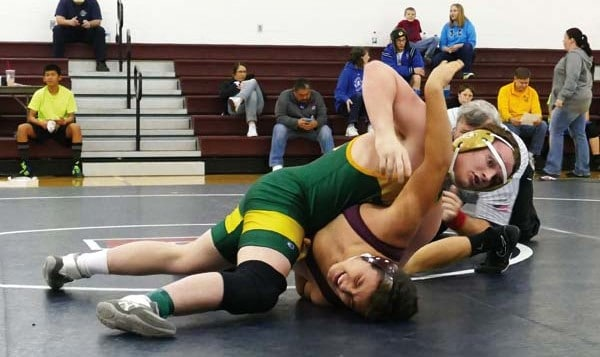 Photo courtesy of Callie Fink Ivan Johnson, in green, pinned  Fermin Martinez of Kittitas on his way to sixth place in the 170-pound division.