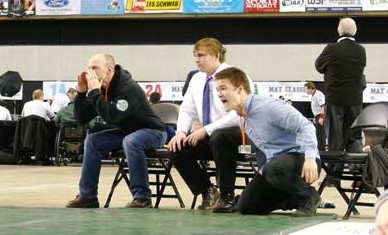 Photo by Callie FinkFrom left, former LBHS coach Paul Schmekel,assistant coach Jon McMillan and head coach Gunnar Doggett offer encouragement.