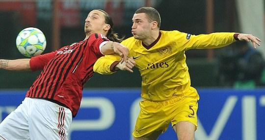 Zlatan Ibrahimovic challenged by Arsenal Thomas  Vermaelen