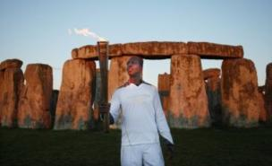 Four-time Olympic gold medallist Michael Johnson carried the torch at Stonehenge (Getty)