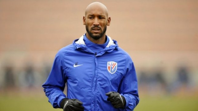 Nicolas Anelka warms up with Shanghai Shenhua