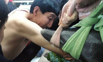 World's tallest man Bao Xishun saves two dolphins with long arms
