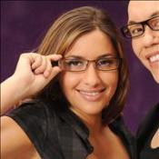Mel raises her glasses to specs gong