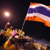 Olympic hero dodges Thai protesters