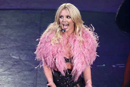 Britney sings about threesomes and her love of counting in 3