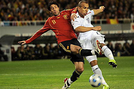 England's Gabriel Agbonlahor gets in a shot in front of Spain's Capdevila