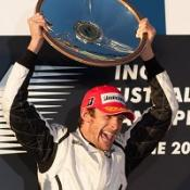 Brawn GP's Jenson Button celebrates winning the Australian Grand Prix in Melbourne