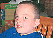 Rhys killer's father arrested for 'gang arson attack'