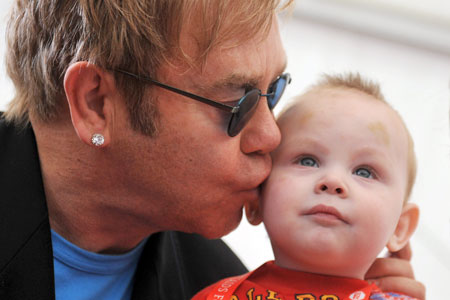 Elton John kisses baby Lev at an orphanage in the town of Makeyevka, in the Ukraine