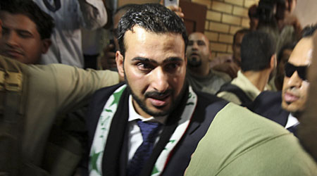 Free: Al-Zeidi is thronged by supporters