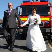 Mike Dyer with his bride Barbara before they were driven by fire engine on their wedding day in Stroud
