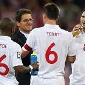 England's Fabio Capello celebrates with his players after the final whistle during the FIFA World Cup qualifying Round match at Wembley Stadium, London.