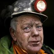 More than 150,000 miners have been improperly charged over compensation, a Labour MP has said