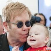 Elton John kisses baby Lev at a orphanage for HIV-positive children in Ukraine