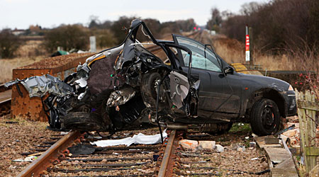 The car was hit on the level crossing