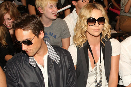 Charlize Theron, right, is in talks to play the female lead in Mad Max 4