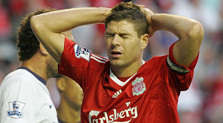 Pain game: Gerrard is set to miss another game for Liverpool at Fulham tomorrow after the injury he picked upon England duty