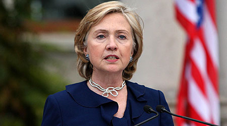 Hillary Clinton is meeting the rival leaders of Northern Ireland's power-sharing government.