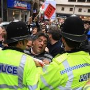 Police hold back members of the public during an English Defence League demo