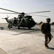 A soldier returns to Camp Bastion on an RAF Sea King helicopter in Afghanistan
