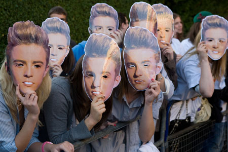 The teen fans of X Factor twins John and Edward Grimes have angered the Chinese Ambassador