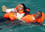 indonesia sumatra island ferry sinking rescue search survivors dumai express survivors floating