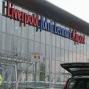 A woman has admitted terror charges after being stopped at John Lennon Airport