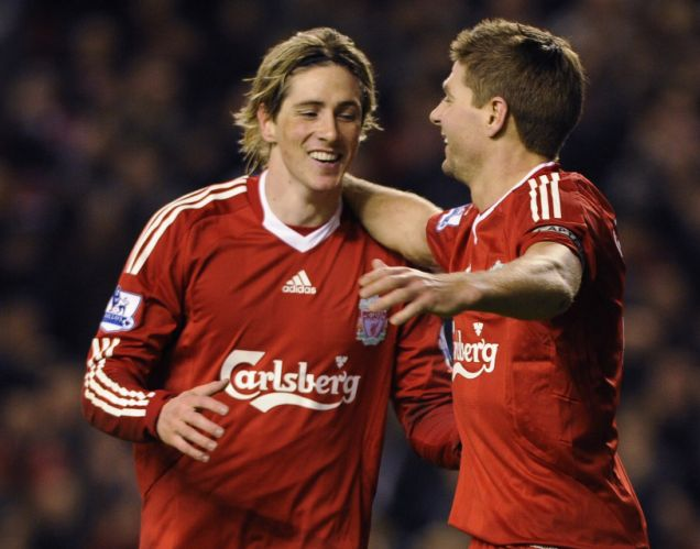 Torres, right, celebrates his strike with Gerrard