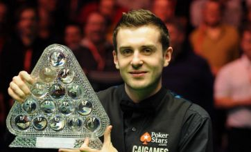 Selby stuns Ronnie to win Masters