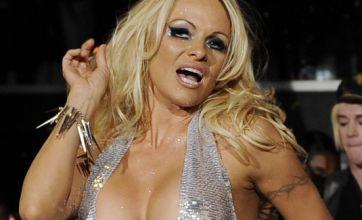 Pamela Anderson shocks in silver for New York Fashion Week
