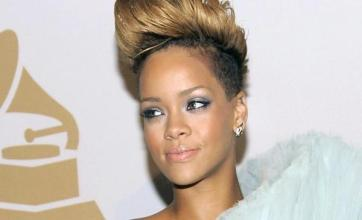 Rihanna attends Clive Davis party