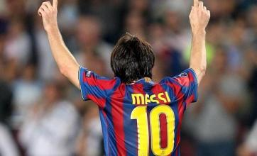 Messi brace puts Barca through