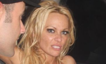 Pamela Anderson flashes her knickers after boozy night out