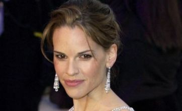 Hilary Swank 'grew up feeling like an outsider'