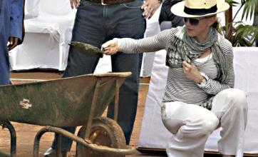 Madonna lays brick for new school