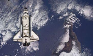 Space shuttle Atlantis prepares to dock