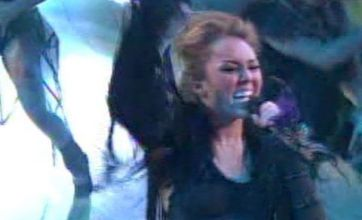 Miley Cyrus in black leather display on Dancing With The Stars