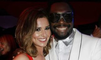 Cheryl Cole and Will.i.am 'hold hands' as they sing surprise duet